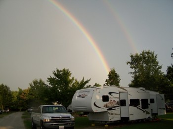 Our RV at Kenisee Lake Jefferson, Ohio after storm rainbow