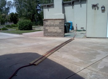 Running the power cord and 3/4 inch 'sewer hose' across the driveway.